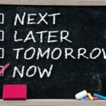 Next, later, tomorrow or now written with white chalk. — Stock Photo #30544609