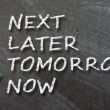 Next, later, tomorrow or now written with white chalk. — Stock Photo