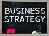 Business Strategy handwritten with white chalk — Stock Photo