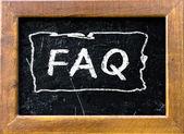 FAQ handwritten with white chalk — Stock Photo