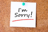 I'm sorry written on an white sticky note — Stock Photo