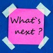What's Next, written on an pink sticky paper — Stock Photo