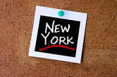 Instant photo pined on cork with New York — Stock Photo