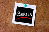 Photo pined on cork with word Berlin — Stock Photo