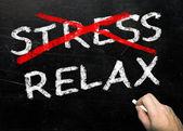 Riscando o stress e escrevendo relaxar — Fotografia Stock