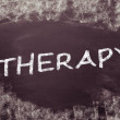 Therapy, written on a blackboard. — Stock Photo