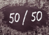 Even fifty-fifty chance written on a blackboard. — Stock Photo