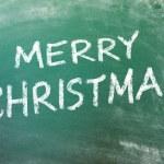 メリー クリスマスのサインオンがあり、greenboard — ストック写真