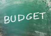 Budget handwritten with chalk on a greenboard — Stock Photo