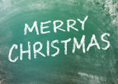 Merry Christmas sign on greenboard — Stock Photo