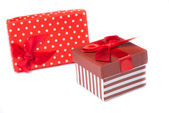 Gift boxes and Red ribbon — Stock Photo
