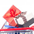 Shopping trolley full of Christmas presents — Stock Photo #34137221
