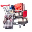 Shopping trolley full of Christmas presents — Stock Photo
