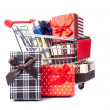 Shopping trolley full of Christmas presents — Stockfoto