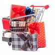 Shopping trolley full of Christmas presents — Stock Photo #34137787