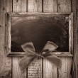 Wooden frame with a red bow — Stock Photo #34221801