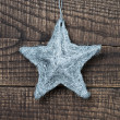 Star on wood background — Stock Photo #34809067