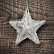 Stock Photo: Star on wood background