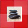 Black stones against bamboo background — Stock Photo