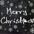 Merry Christmas on wood background — Stock Photo