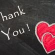 Thank You handwritten with white chalk on a blackboard — Stock Photo
