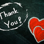 Thank You handwritten with white chalk on a blackboard — Stock Photo #36527969