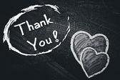 Tack handskrivna med vit krita på en svart tavla. — Stockfoto