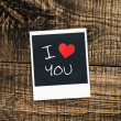Old pictures on wood background.Handwrit ten I Love You — Stock Photo #36792561