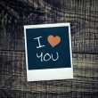 Old pictures on wood background.Handwrit ten I Love You — Stock fotografie