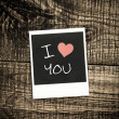 Old pictures on wood background.Handwrit ten I Love You — Stock Photo #36793393