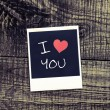 Old pictures on wood background.Handwrit ten I Love You — Stock Photo #36793473