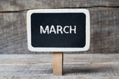 March on Small wooden framed blackboard — Stock Photo