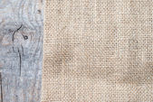 在木桌上的麻布纹理 — 图库照片