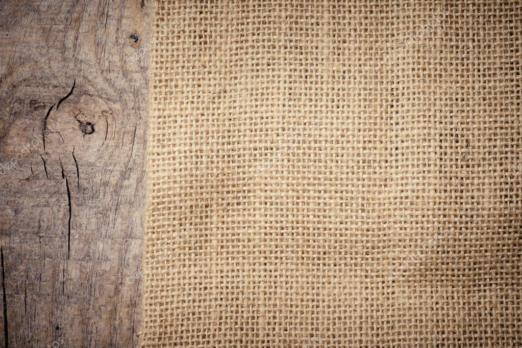 Download - Burlap texture on wooden table — Stock Image #37176835