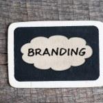 Branding handwritten with white chalk on a blackboard — Stock Photo #37625691