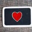 Love heart symbol on a blackboard — Stock Photo #37627459