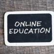 Online education handwritten with white chalk on a blackboard — Stock Photo