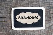 Branding handwritten with white chalk on a blackboard — Stock Photo