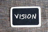 Vision handwritten with white chalk on a blackboard — Stock Photo