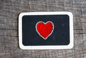 Love heart symbol on a blackboard — Photo