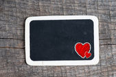 Love heart symbol on a blackboard — Stock fotografie