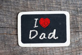 Hand writing I Love Dad on chalkboard — Stock Photo