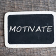 Motivate handwritten with white chalk on a blackboard — Stock Photo