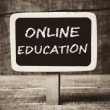 Online education handwritten with white chalk on a blackboard — Stock Photo #37634893