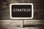 Strategy writen on a Blackboard with white chalk — Stok fotoğraf