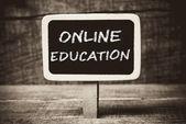Online education handwritten with white chalk on a blackboard — Stockfoto