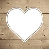 Srdce na dřevěné pozadí — Stock fotografie