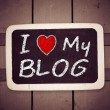 I love my blog handwritten with white chalk on a blackboard — Stock Photo