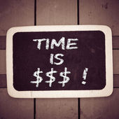 """""""Time is money"""" handwritten with chalk — Stock Photo"""