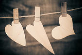 Hearts hanging on a rope with pins — Stock Photo